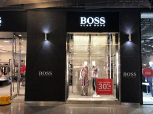 Photo of a Huge Boss store entrance with mannequins in the window