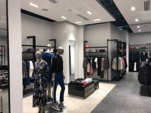 Inside a Hugo Boss store displaying various mannequins