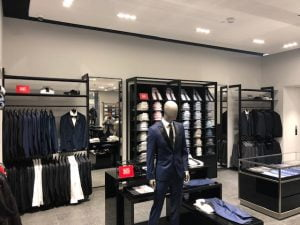 Inside a Hugo Boss store displaying a mannequin wearing a blue suit