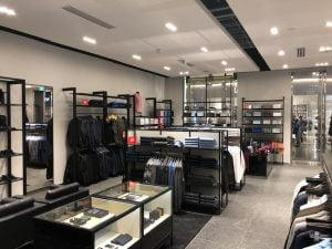 Inside a Hugo Boss store displaying products alternative angle