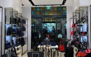 Wide shot of the inside of a Tumi store