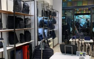 Inside of a Tumi store, showing luggage