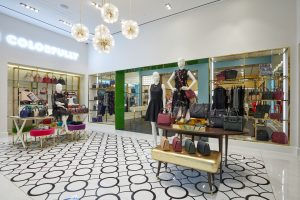 Wide shot of the inside of a Kate Spade New York store with various mannequins