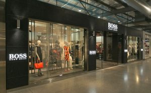 Photo of a Huge Boss store entrance with mannequins in the window alternative angle 2