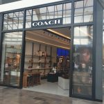 Outside of the store Coach alt 1