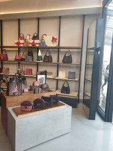 Photo of handbags on display in a store
